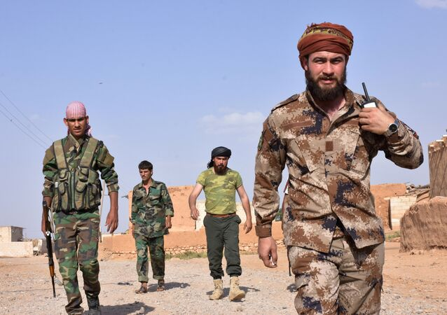 Syrian pro-government forces walk in the northern Syrian town of Maskanah after they took control of the town from Islamic State (IS) group jihadists on June 5, 2017
