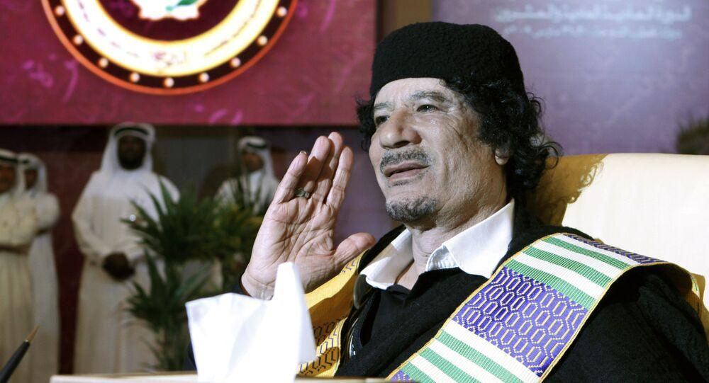 Libyan leader Moammar Gadhafi gestures during the Arab summit in Doha, Qatar, Monday, March 30, 2009