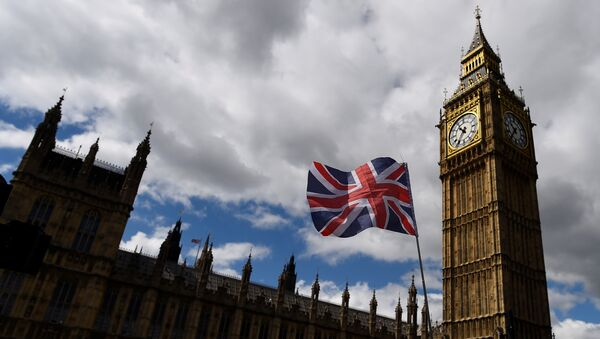 The Union Flag flies near the Houses of Parliament the day before a general election in central London, Britain June 7, 2017. - Sputnik International