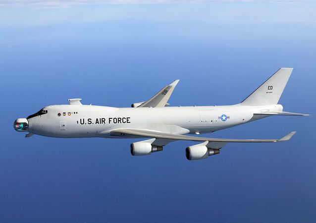 The since-abandoned YAL-1A Airborne Laser system in flight with its mirror unstowed