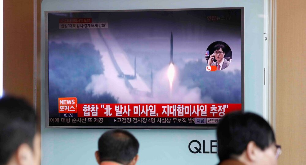 People watch a TV broadcast of a news report on North Korea firing what appeared to be several land-to-ship missiles off its east coast, at a railway station in Seoul, South Korea, June 8, 2017.