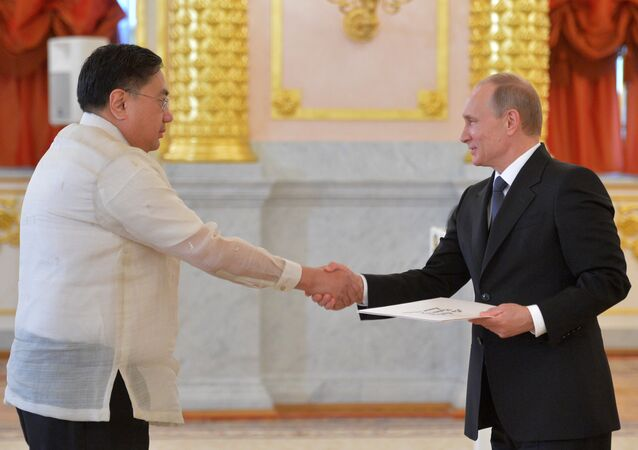 May 28, 2015. Russian President Vladimir Putin (right) and Ambassador Extraordinary and Plenipotentiary of the Republic of the Phillipines to the Russian Federation Carlos Sorreta are in the Alexander Hall of the Grand Kremlin Palace during the ceremony of presenting credentials by new ambassadors of some foreign countries.