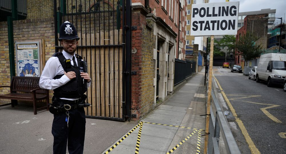 A police officer stands on duty outside a polling station in Tower Hamlets, London, Britain June 8, 2017.