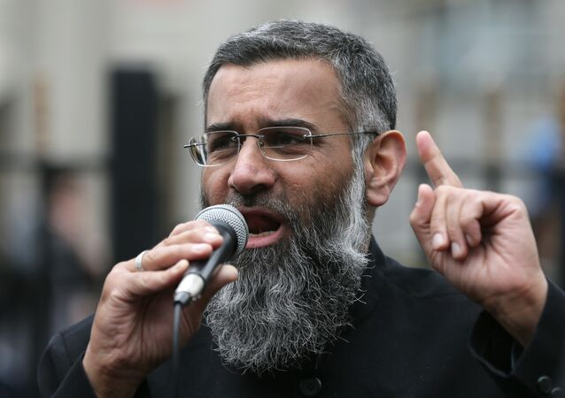 Anjem Choudary, right, a British Muslim social and political activist and spokesman for Islamist group, Islam4UK, speaks following prayers at the Central London Mosque in Regent's Park, London, Friday, April 3, 2015.