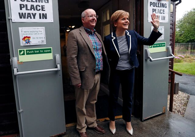 First Minister of Scotland Nicola Sturgeon and her husband Peter Murrell pose after voting in Glasgow, Britain