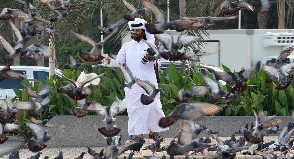 A man looks at pigeons at Souq Waqif market in Doha, Qatar, June 6, 2017.