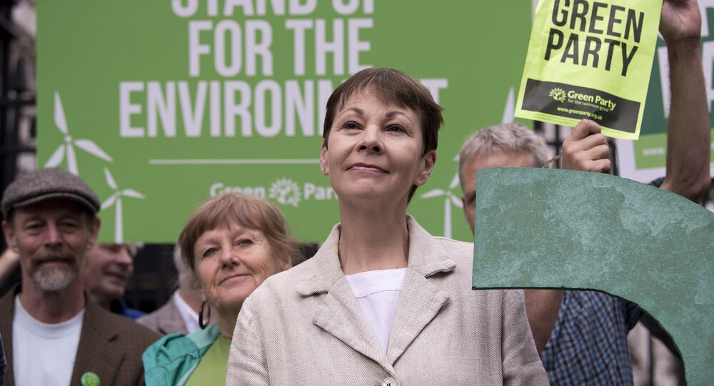 Green Party co-leader Caroline Lucas poses for a photograph with a green question mark outside the entrance to Downing Street in central London on May 30, 2017