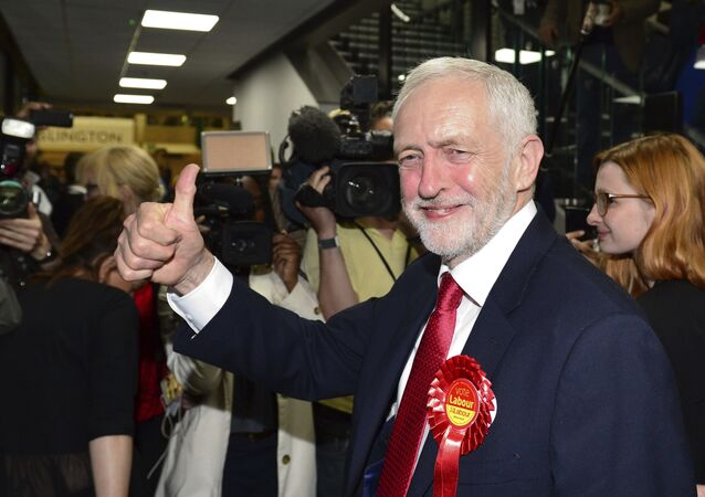 Britain's Labour party leader Jeremy Corbyn gestures as he arrives for the declaration at his constituency in London, Friday, June 9, 2017.