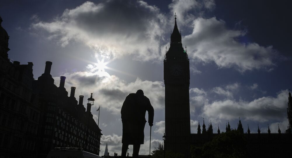 A statue of former British Prime Minister Winston Churchill silhouettes in front of the Houses of Parliament the day after Britain's national elections in London, Friday, June 9, 2017.