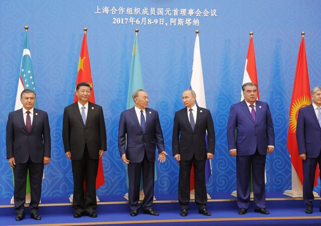 June 9, 2017. President Vladimir Putin poses for photographs with the participants of the meeting of the Council of Heads of State of the Shanghai Cooperation Organization (SCO). From left: President of Uzbekistan Shavkat Mirziyoyev, President of China Xi Jinping, President of Kazakhstan Nursultan Nazarbayev. From right: President of Kyrgyzstan Almazbek Atambayev, President of Tajikistan Emomali Rahmon.