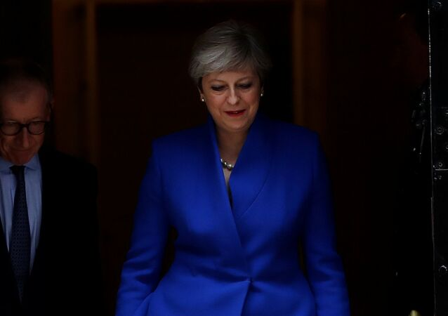 Britain's Primer Minister Theresa May leaves Downing Street on her way to Buckingham Palace after Britain's election in London, Britain