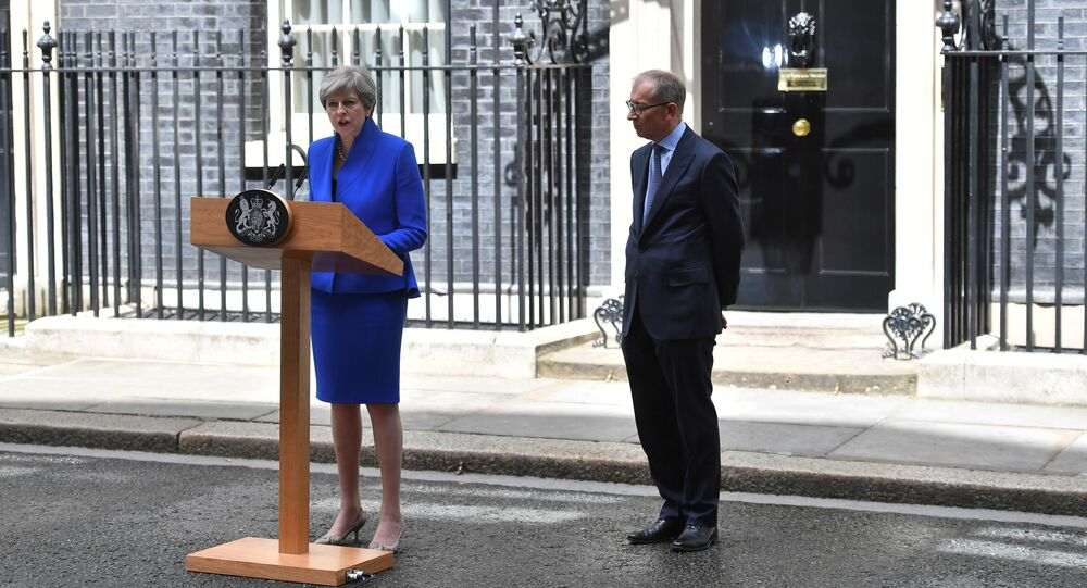 Britain's Prime Minister and leader of the Conservative Party Theresa May, (L), accompanied by her husband Philip, delivers a statement outside 10 Downing Street in central London on June 9, 2017 as results from a snap general election show the Conservatives have lost their majority.