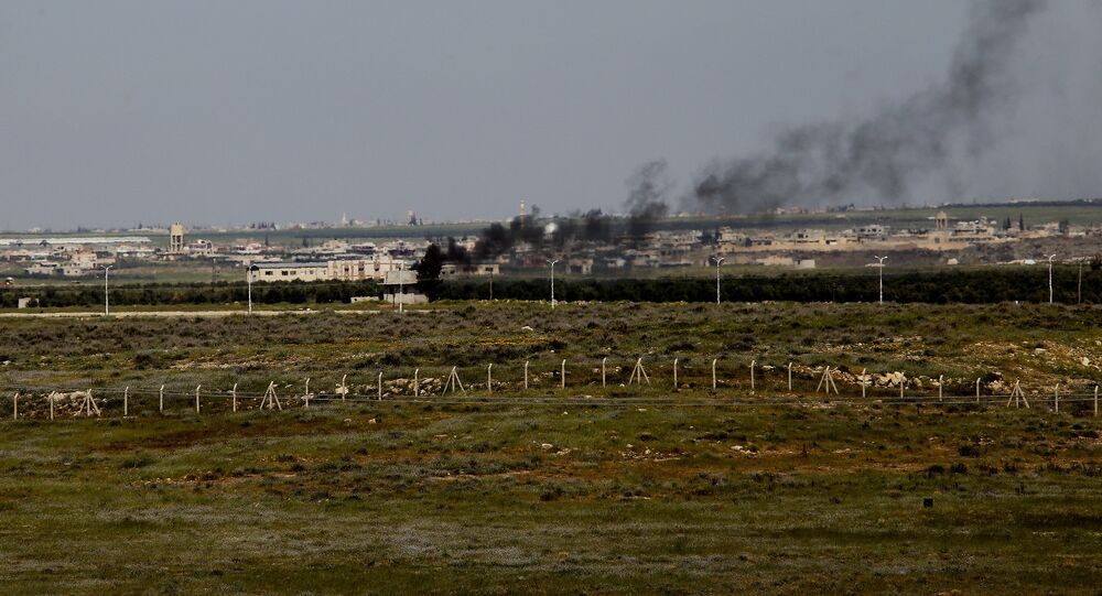 Smoke rises in the Syrian town of Nasib, as seen from the Jordanian town of Jaber, north of Mafraq (file)