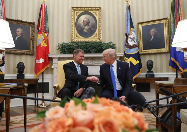 President Donald Trump greats Romanian President Klaus Werner Iohannis, in the Oval Office at the White House, Friday, June 9, 2017, in Washington.