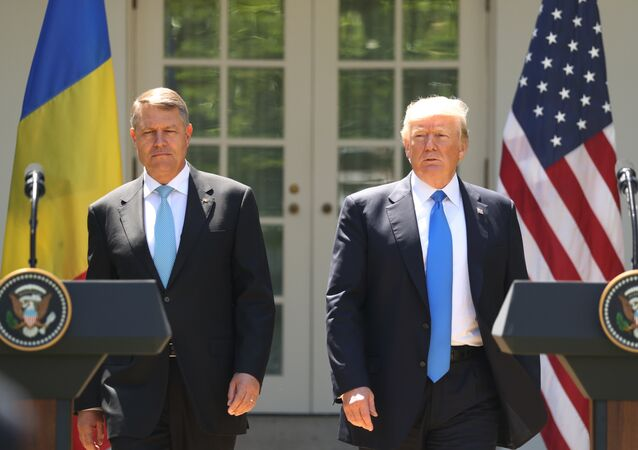 President Donald Trump, accompanied by Romanian President Klaus Werner Iohannis, walk to the dais to begin a news conference in the Rose Garden at the White House, Friday, June 9, 2017, in Washington.