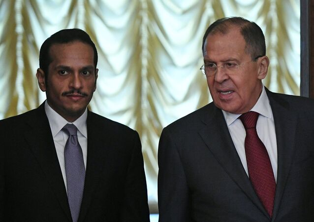 Russian Foreign Minister Sergey Lavrov, right, and his Qatari counterpart Mohammed Al Thani during their meeting in Moscow