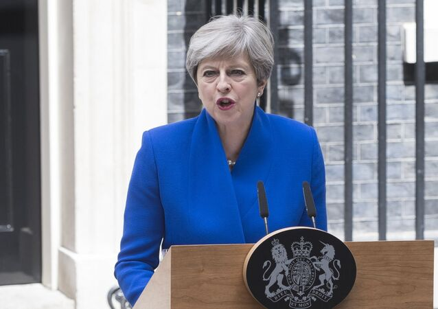 UK Prime Minister Theresa May makes a statement after meeting with the Queen. Theresa May received a permission from the Queen to form a new cabinet of ministers