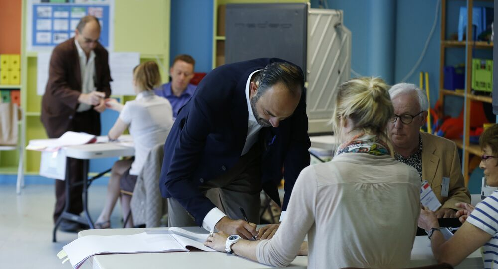 French Prime Minister Edouard Philippe prepares to cast his ballot at a polling station during the first round of legislative elections on June 11, 2017 in Le Havre, northern France.