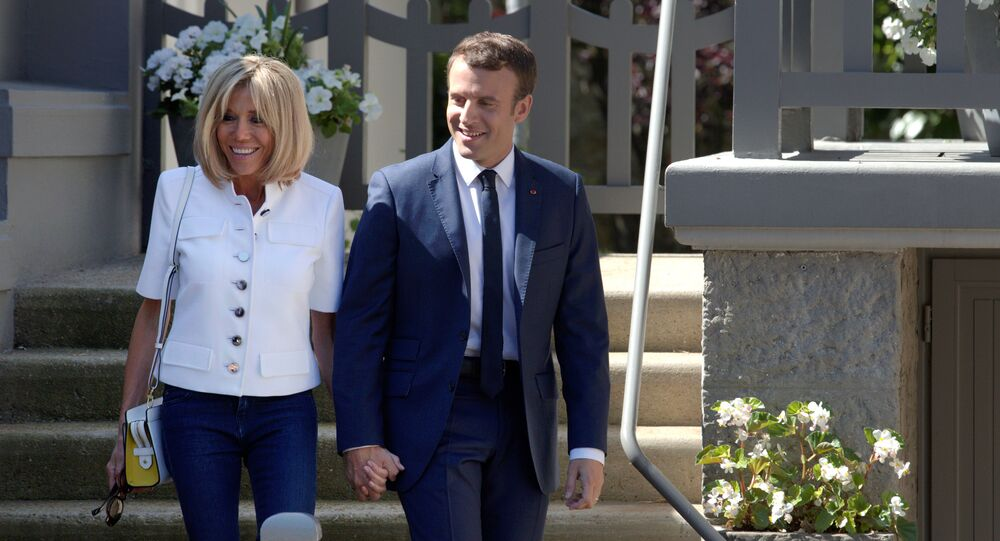 French President Emmanuel Macron and wife Brigitte leave home before voting in the first of two rounds of parliamentary elections in Le Touquet, France, June 11, 2017.