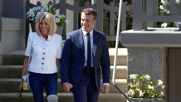 French President Emmanuel Macron and wife Brigitte leave home before voting in the first of two rounds of parliamentary elections in Le Touquet, France, June 11, 2017. - Sputnik International