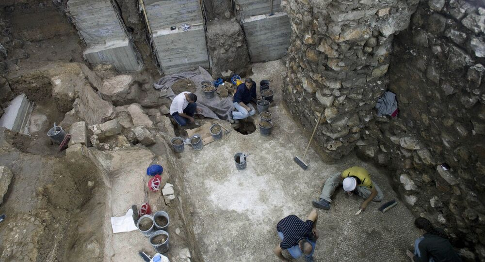 Workers of the Israeli Antiquities Authority work at an excavation site in Jerusalem's Old City. (File)