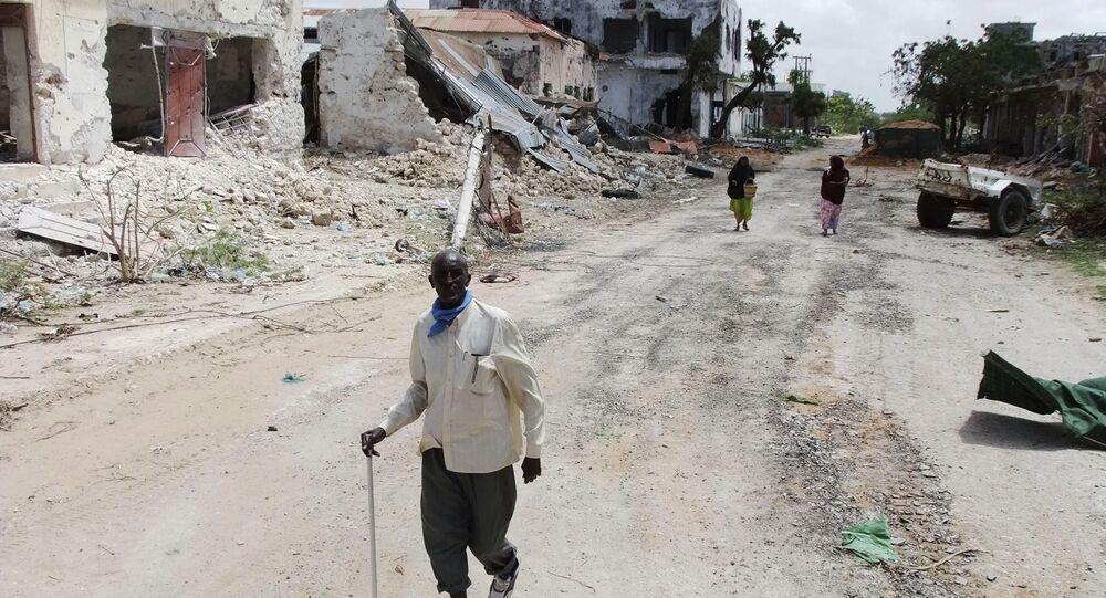 Civilians walk along a street in Mogadishu, Somalia. (File)