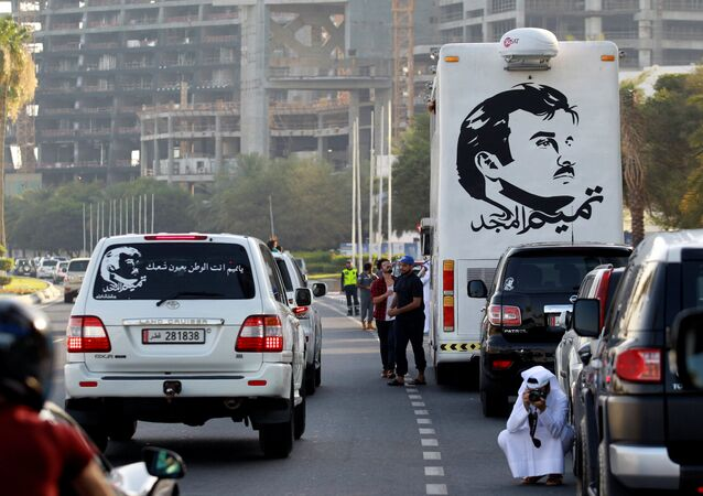 A painting depicting Qatar's Emir Sheikh Tamim Bin Hamad Al-Thani is seen on a bus during a demonstration in support of him in Doha, Qatar June 11, 2017