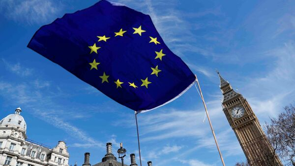An EU flag flies above Parliament Square during a Unite for Europe march, in London, Britain March 25, 2017 - Sputnik International