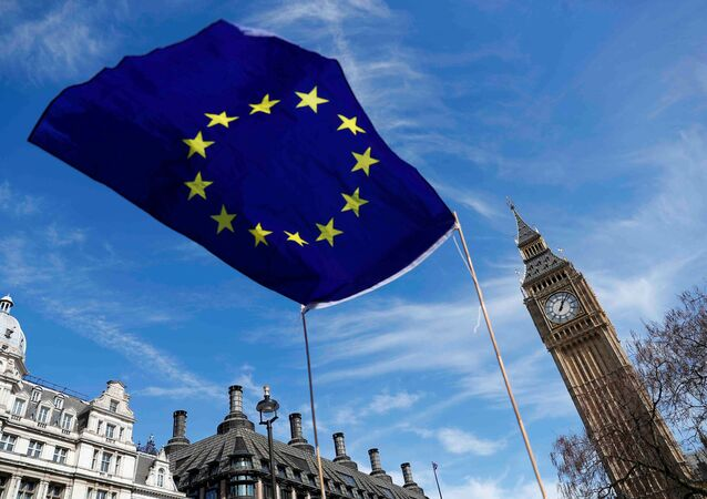 An EU flag flies above Parliament Square during a Unite for Europe march, in London, Britain March 25, 2017
