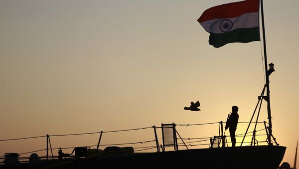 Indian navy person stands guard on board war ship Godavari during its decommissioning at the naval dockyard in Mumbai, India, Wednesday, Dec. 23, 2015 - Sputnik International