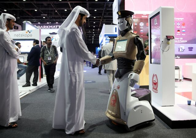 A visitor shakes hands with an operational robot policeman at the opening of the 4th Gulf Information Security Expo and Conference (GISEC) in Dubai, United Arab Emirates, May 22, 2017. Picture taken May 22, 2017