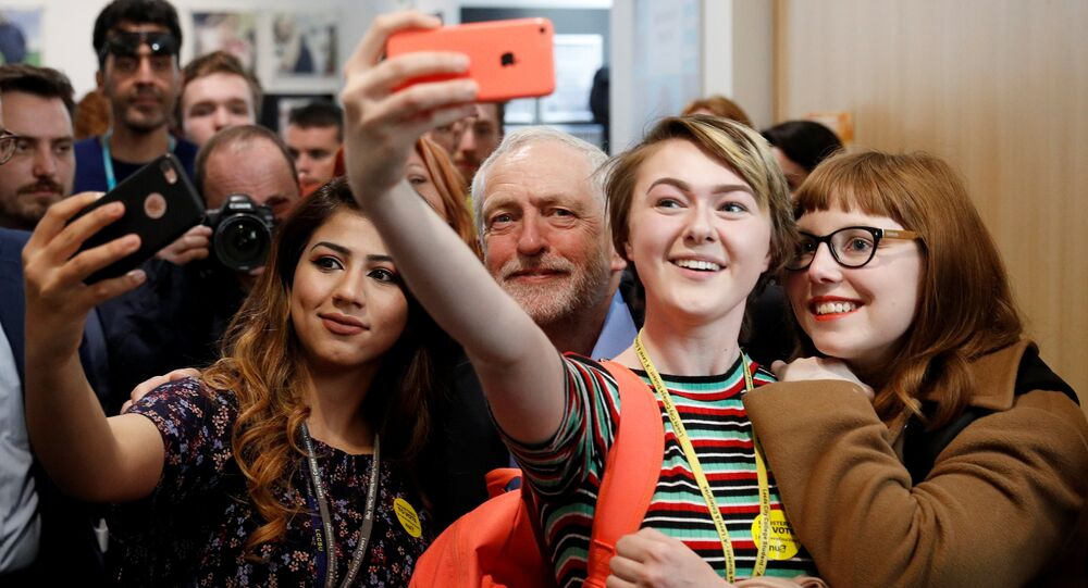 Jeremy Corbyn, the leader of Britain's opposition Labour Party, poses for selfies at a campaign event in Leeds, May 10, 2017.