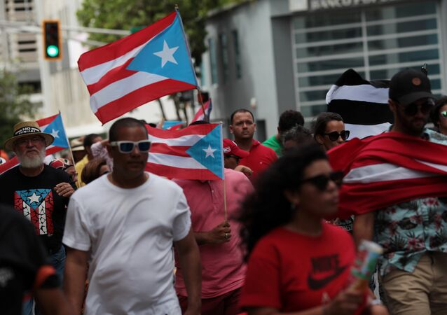 People march in support of Puerto Rico becoming an independent nation as the economically struggling US island territory voted overwhelmingly on Sunday in favour of becoming the 51st state, in San Juan, Puerto Rico, 11 June 2017