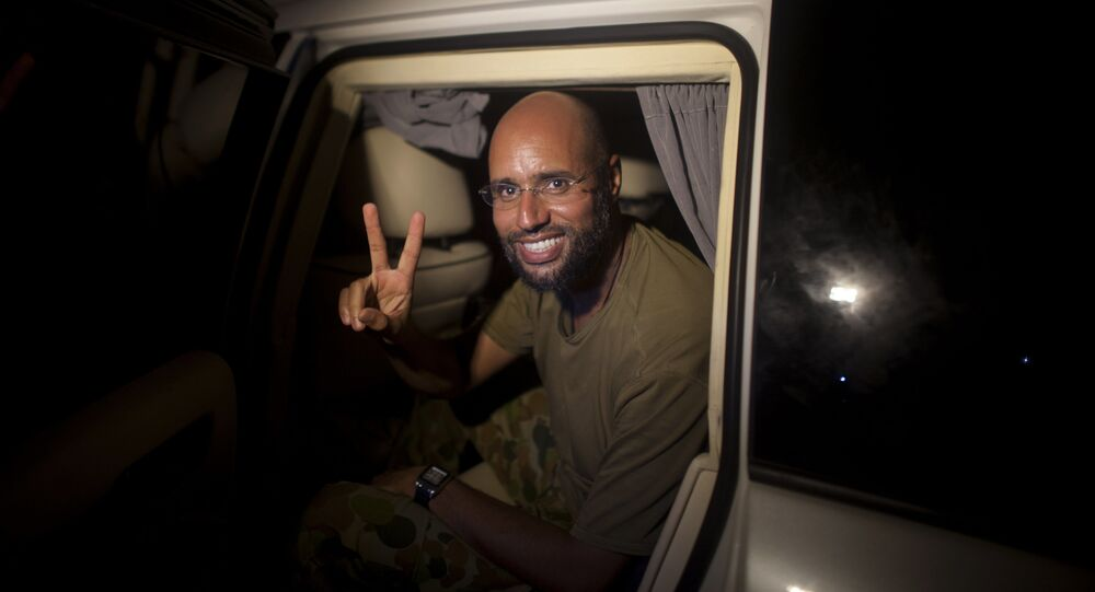 Moammar Gadhafi's son Seif al-Islam makes the victory sign as he appears at the Rixos hotel in Tripoli, Libya (File)