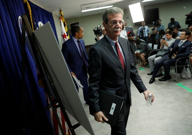 Maryland Attorney General Brian Frosh (C) and District of Columbia Attorney General Karl Racine (L) conclude a news conference to announce their lawsuit against U.S. President Donald Trump on the issue of the U.S. Constitution's emoluments clauses and Trump's business ventures, in Washington, DC, U.S. June 12, 2017