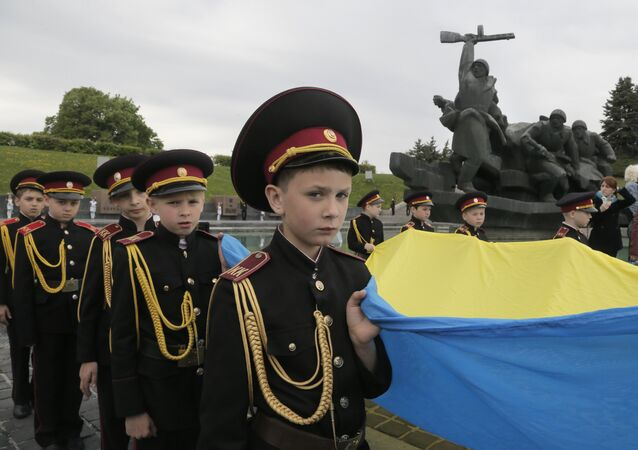 Military cadets carry the Ukrainian National flag during a parade of Kiev military schools, within the program of military and patriotic education, to celebrate Victory Day at the WWII memorial in Kiev, Ukraine, Tuesday, May 5, 2015