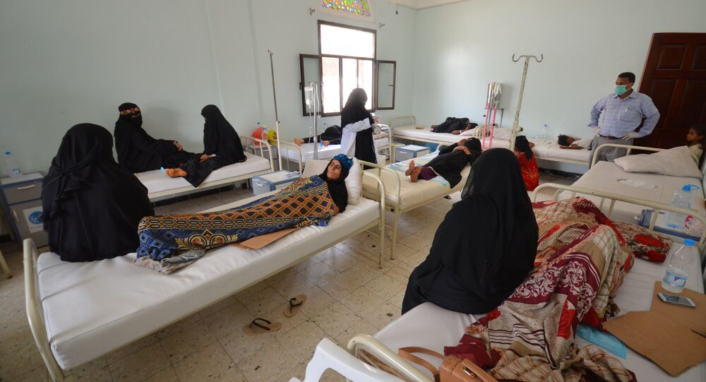 Women sit with relatives infected with cholera at a hospital in the Red Sea port city of Hodeidah, Yemen May 14, 2017