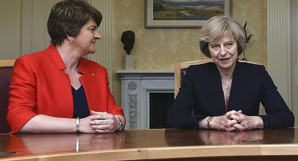 This is a July 25, 2016 file photo of of Arlene Foster, left, leader of the Democratic Unionist Party, with Britain's Prime Minister Theresa May, during a meeting in Belfast.