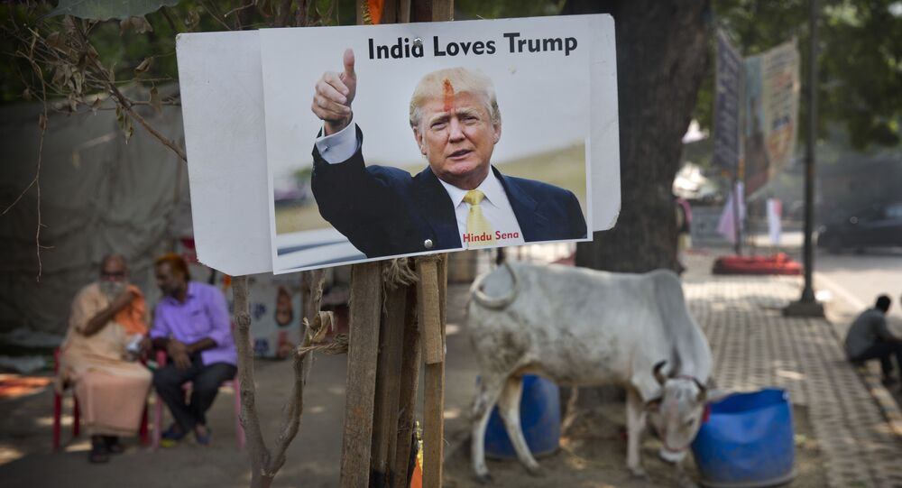 A photograph of U.S. presidential candidate Donald Trump is displayed by activists belonging to 'Hindu Sena' or Hindu Army, a local organization in anticipation of his victory in New Delhi, India, Wednesday, Nov. 9, 2016