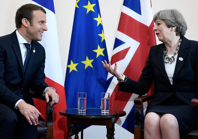Britain's Prime Minister Theresa May and French President Emmanuel Macron talk during a bilateral meeting at the G7 Summit in Taormina, Sicily, Italy, May 26, 2017.