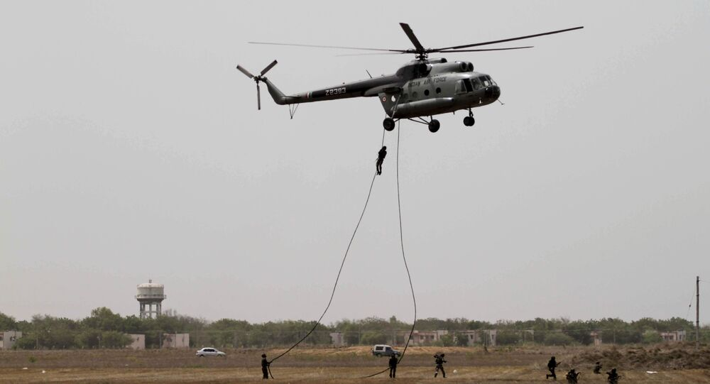 Garud commandos of Indian air force performs from an MI-8 helicopter during the inducting ceremony of first Medium Power Radar (MPR) named Arudhra, seen background, at the Air Force Station Naliya (File)