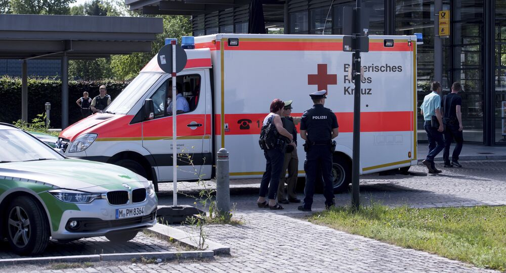 An ambulance stands near a subway station in Munich, Germany, Tuesday, June 13, 2017