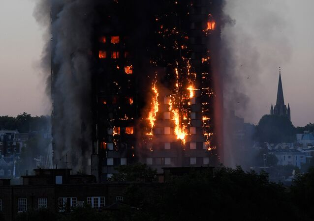 Flames and smoke billow as firefighters deal with a serious fire in a tower block at Latimer Road in West London, Britain June 14, 2017