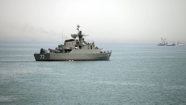 In this Tuesday, April 7, 2015, file photo released by the semi-official Fars News Agency, Iranian warship Alborz, foreground, prepares before leaving Iran's waters, at the Strait of Hormuz - Sputnik International