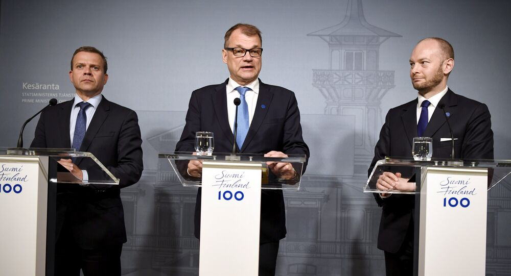Finnish Minister of Finance National Coalition Party chairman Petteri Orpo (L), Finnish Prime Minister Centre Party chairman Juha Sipilä (C) and minister Sampo Terho from the New Alternative, attend a press conferance at the PM's official residence Kesäranta in Helsinki, Finland on June 13, 2017 where all parliament parties and their chairmen were summoned