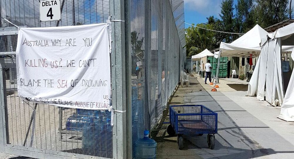 A sign adorns the security fence near shelters inside the Manus Island detention centre in Papua New Guinea, February 11, 2017