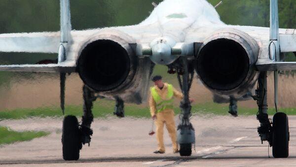 Aeromechanic conducts preflight inspection of the Su-27 before the start of the training flight at the Chkalovsk airport in the Kaliningrad region. File photo - Sputnik International