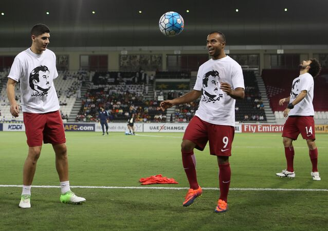 Qatar's national team players wear t-shirts bearing portraits of Emir Sheikh Tamim bin Hamad Al-Thani, in support the Qatari leader in the ongoing diplomatic crisis surrounding Qatar and other Gulf countries as they warm up prior to their World Cup 2018 Asia qualifying football match between Qatar and South Korea at the Jassim Bin Hamad stadium in Doha on June 13, 2017.