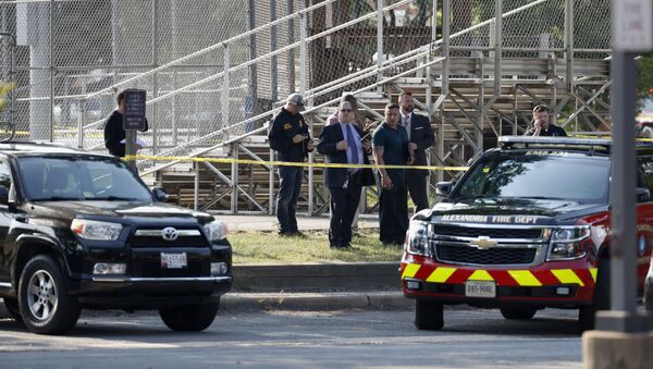 Law enforcement officers investigate the scene of a shooting near a baseball field in Alexandria, Va., Wednesday, June 14, 2017, where House Majority Whip Steve Scalise of La. was shot at a Congressional baseball practice - Sputnik International