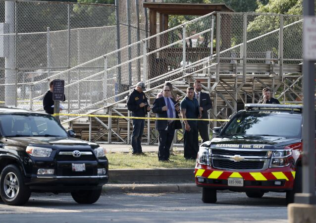 Law enforcement officers investigate the scene of a shooting near a baseball field in Alexandria, Va., Wednesday, June 14, 2017, where House Majority Whip Steve Scalise of La. was shot at a Congressional baseball practice